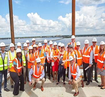 Local dignitaries pose on the 12th floor of the Luminary Hotel during the Topping Out Ceremony