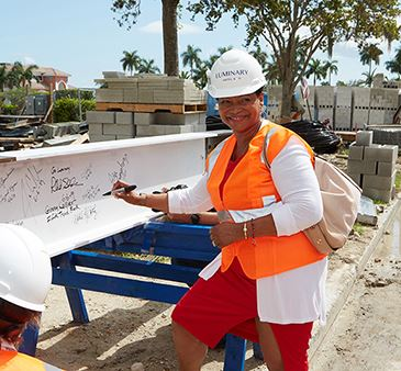 Fort Myers Community Redevelopment Agency Executive Director Michele Hylton-Terry signs the final be