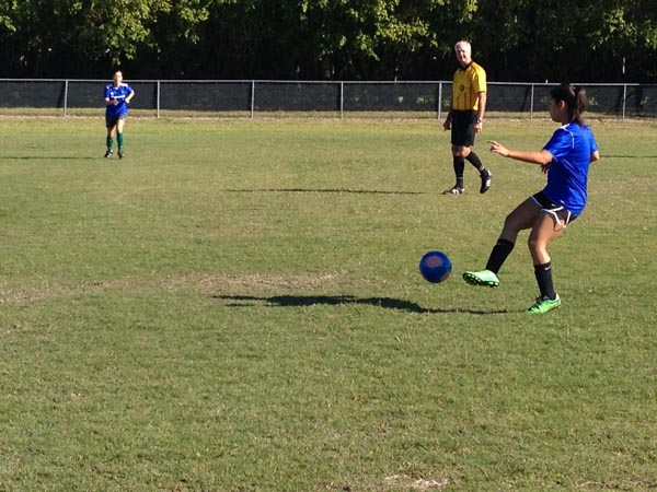 Player traps the ball and prepares to kick