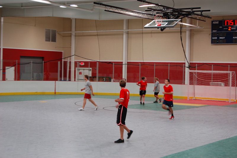 Indoor soccer coed team playing match
