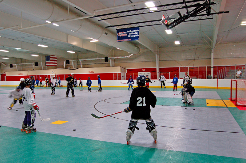 Player shooting in roller hockey practice