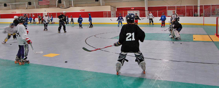 Roller hockey player prepares to shoot