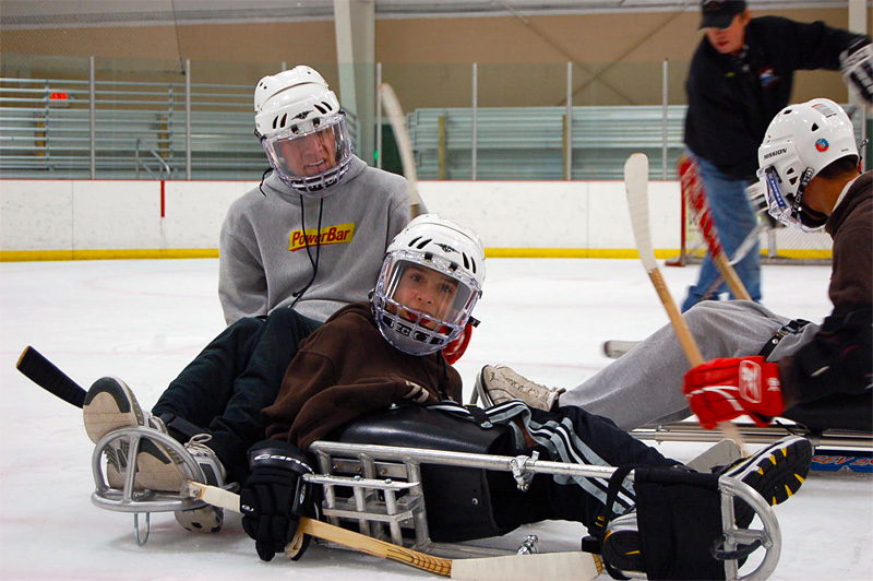 Sled hockey player falls on ice