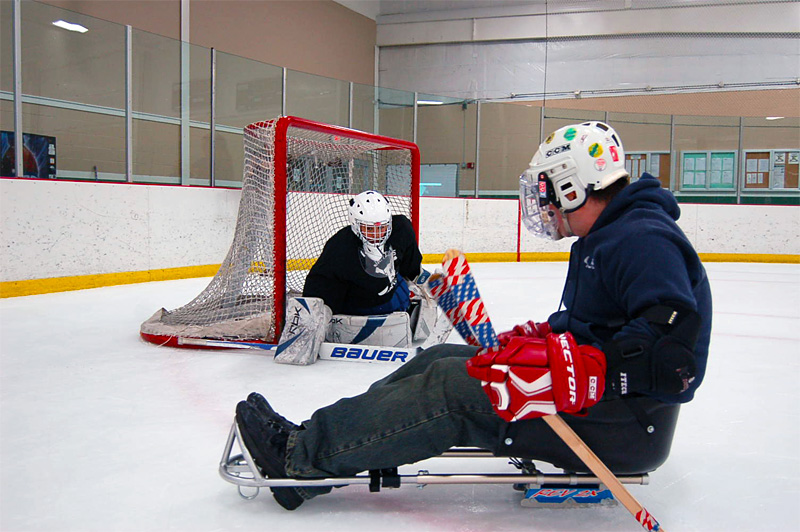 Sled hockey players attempts to shoot