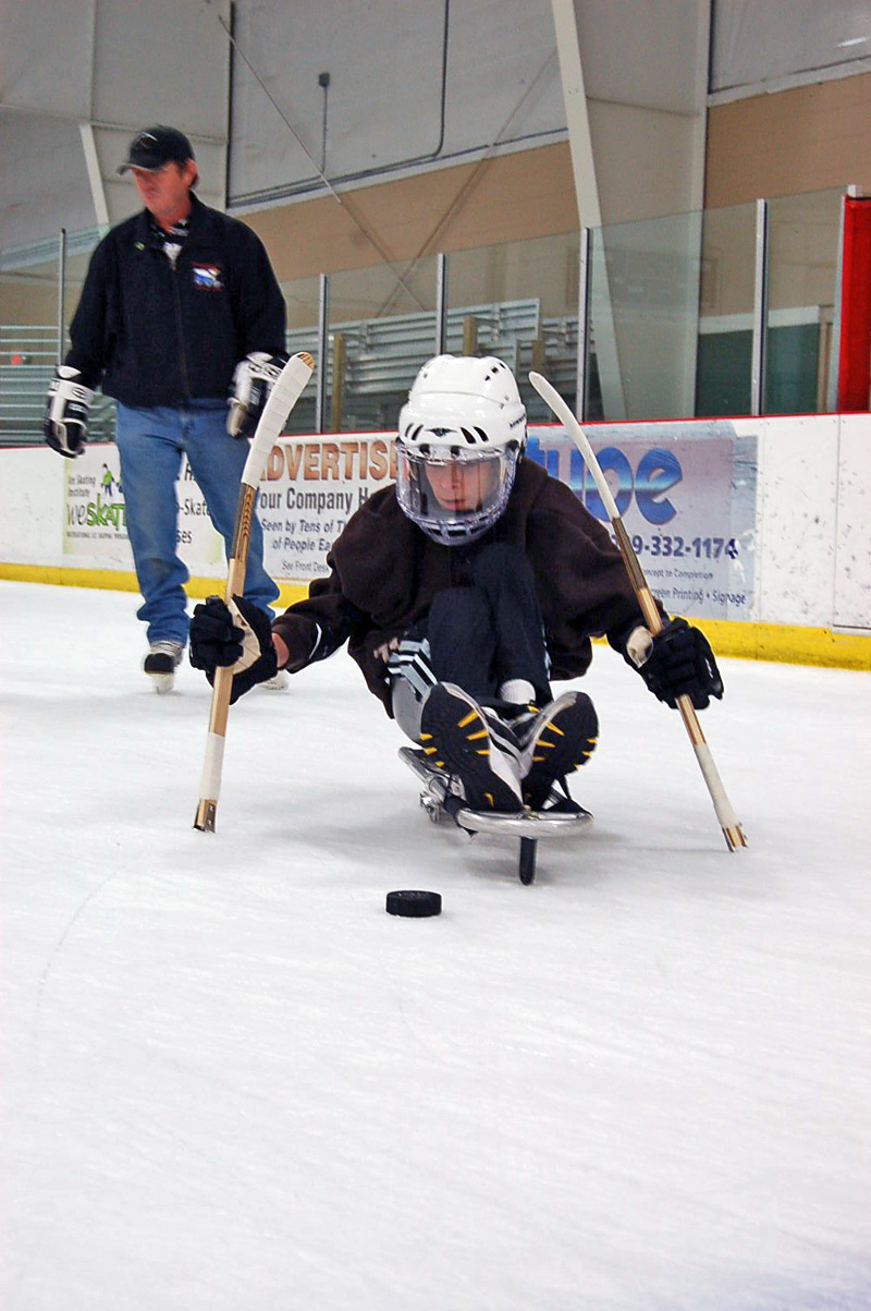 Sled roller hockey on ice