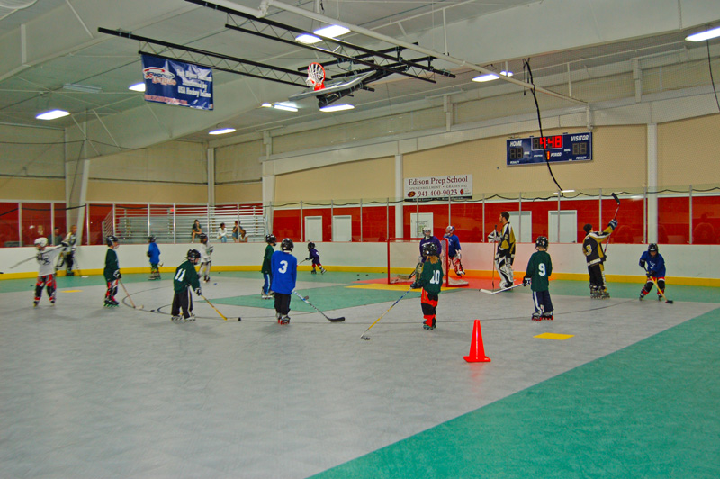 Youth indoor roller hockey practice
